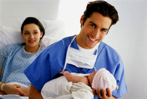 2002 --- Father Holding Newborn --- Image by © Royalty-Free/Corbis