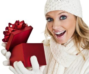 A Generic Photo of a woman opening a Christmas gift. See PA Feature BEAUTY Xmas Gifts. Picture credit should read: PA Photo/thinkstockphotos. WARNING: This picture must only be used to accompany PA Feature BEAUTY Xmas Gifts.