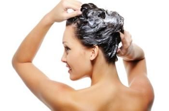 Portrait of young beautiful woman washing her head