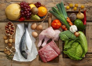 Various Paleo diet products on wooden table, top view