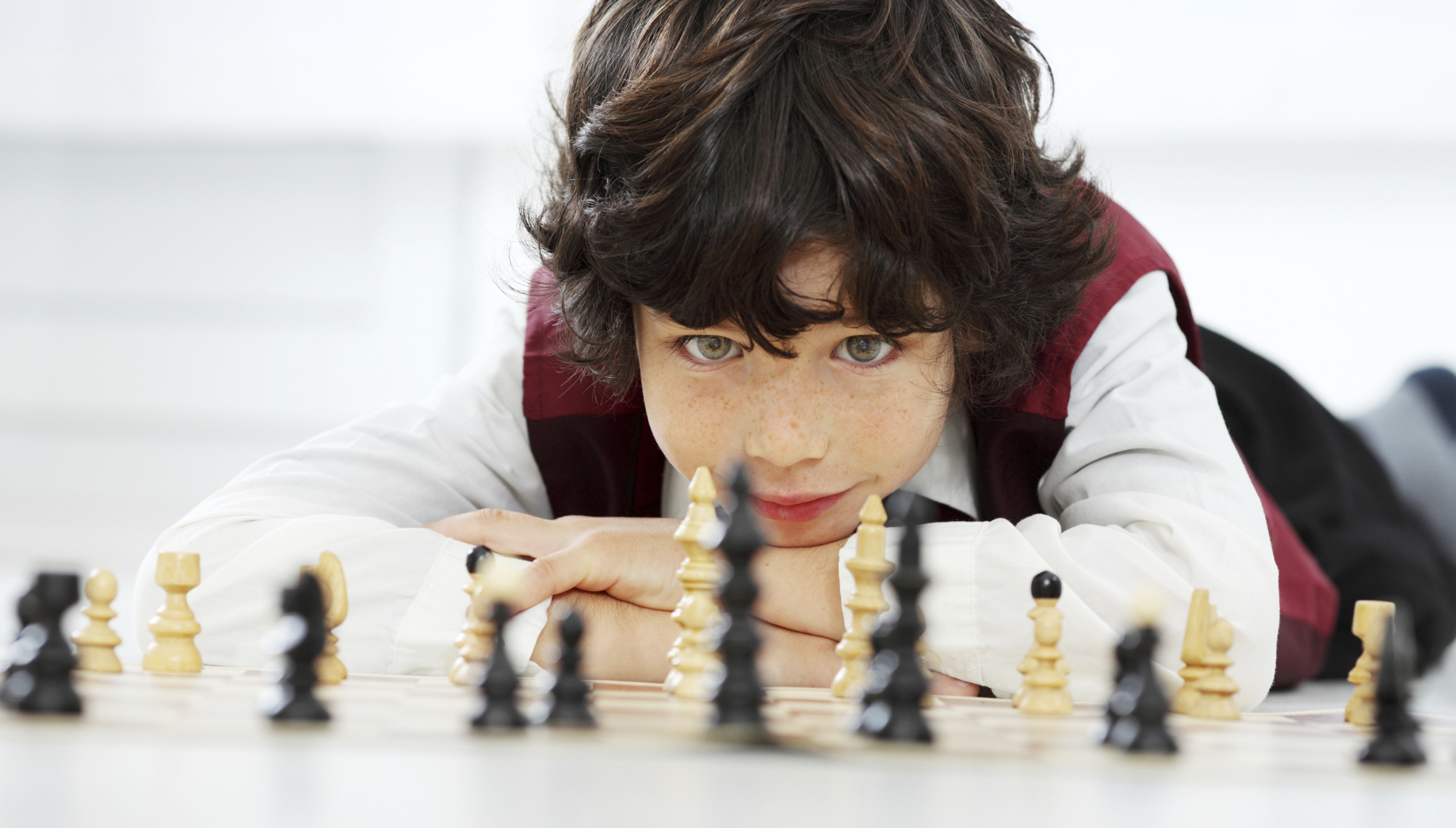 Portrait of an 8 year old boy thinking and looking at chess pieces.  [url=http://www.istockphoto.com/search/lightbox/9786766][img]http://img255.imageshack.us/img255/3431/sportt.jpg[/img][/url]  [url=http://www.istockphoto.com/search/lightbox/9786682][img]http://img638.imageshack.us/img638/2697/children5.jpg[/img][/url]