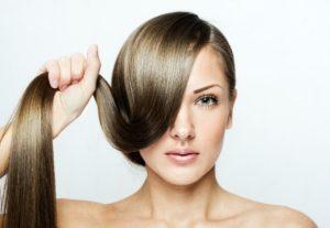 beautiful woman with long natural shiny hair , brown hair