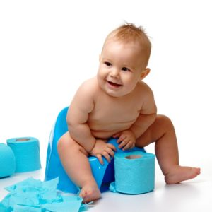 Child on potty play with toilet paper, isolated over white