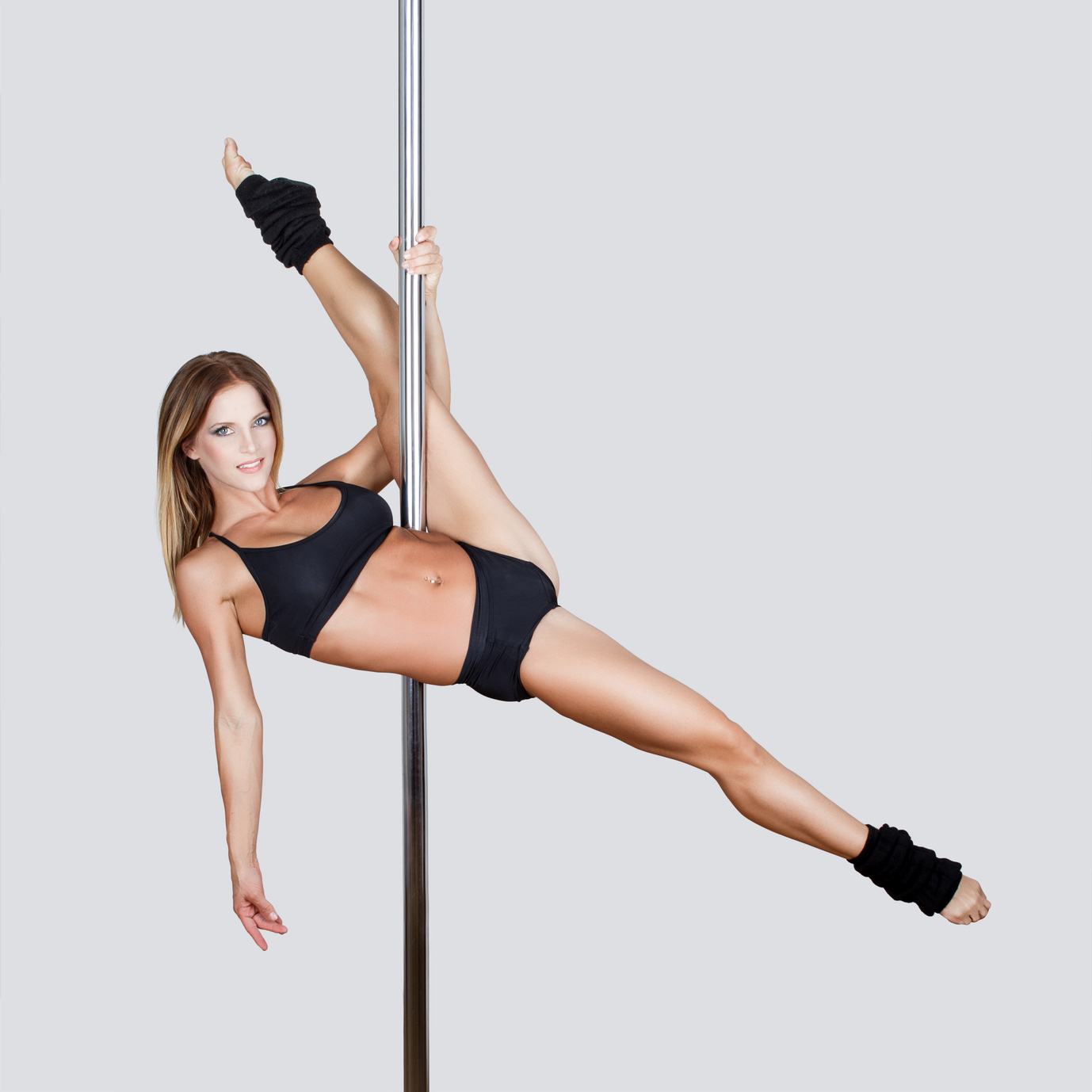 Sexy pole dancer leg up, grey empty space