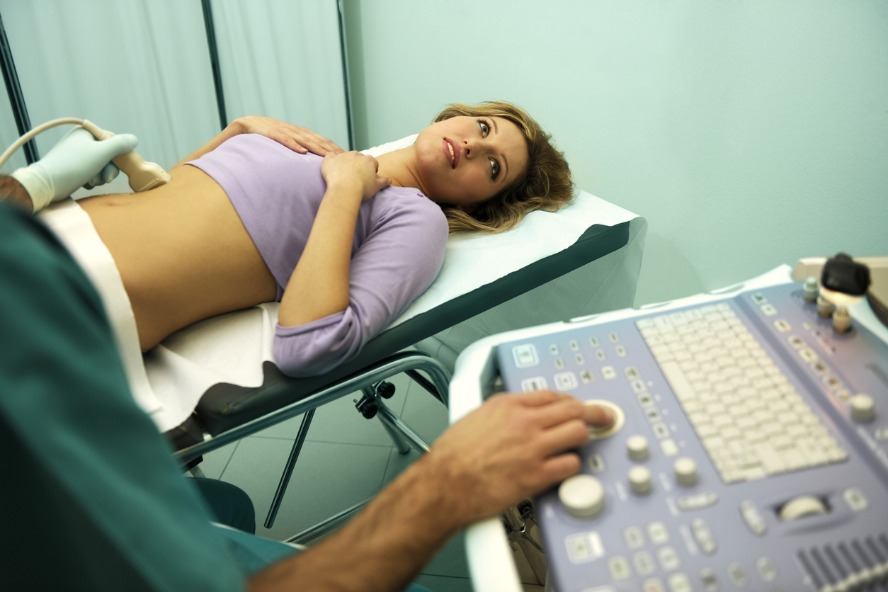 Doctor using ultrasound machine