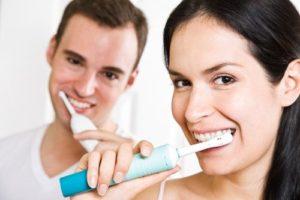 young-man-and-woman-brushing-teeth-00120093-klumba-post