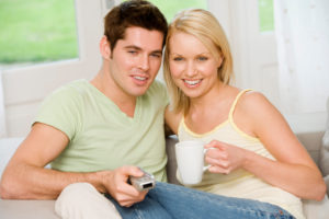 Couple with television remote
