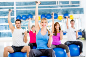 Group of people working out at the gym